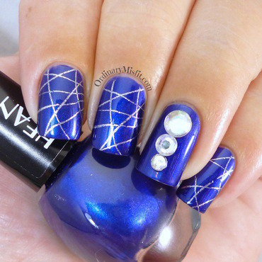 Silver webbed blue nail art by Michelle