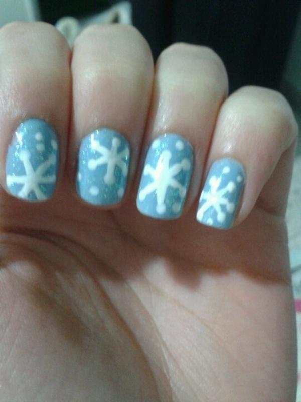 Snowflakes nail art by Maya Harran