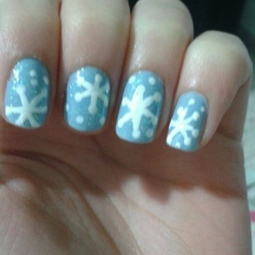 Snowflakes nail art by Maya Harran