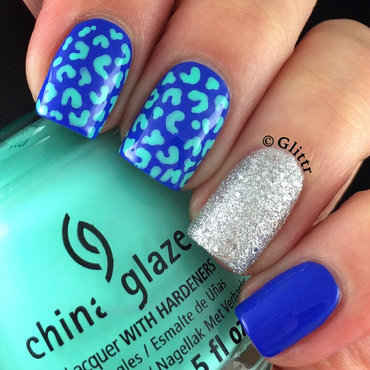 Blue and turquoise leopard print nail art by Glittr