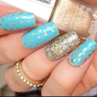Gold & blue  nail art by Virginia