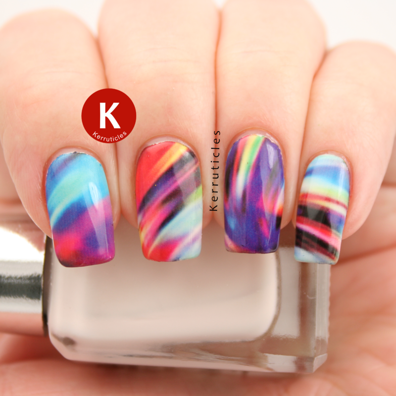 Multi-coloured swirls (water decals) nail art by Claire Kerr