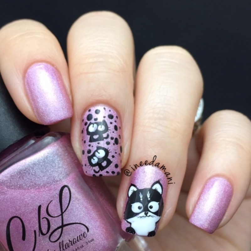 Kitty nail art by Carmen Ineedamani