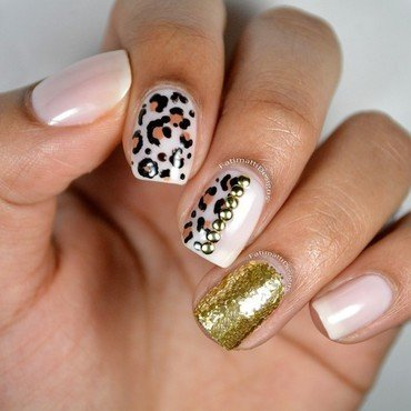 Leopard Print with Glitter Bomb Accent nail art by Fatimah