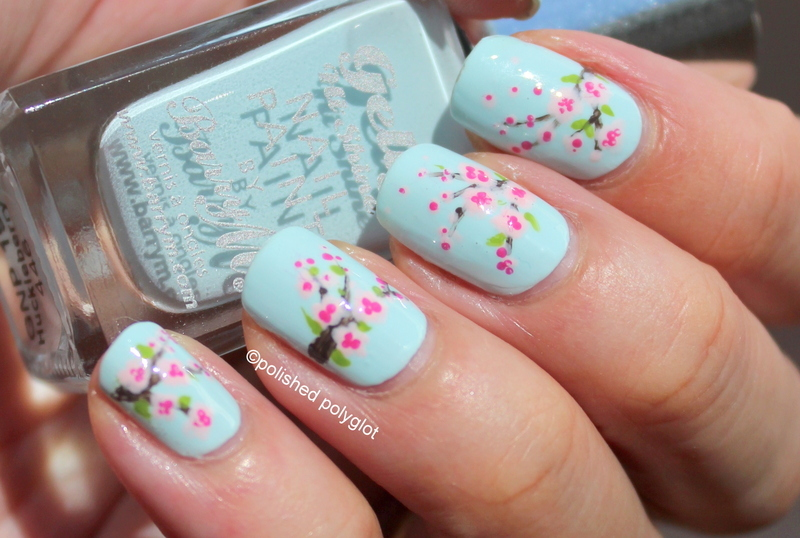 Cherry blossoms over light blue nail art by Polished Polyglot