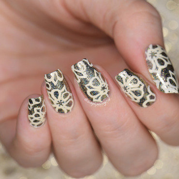 Delicate ivory lace over platinum flakie base nail art by simplynailogical