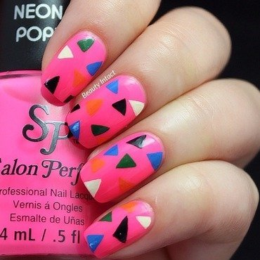 Colored Triangles nail art by Beauty Intact