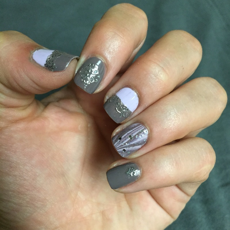 Silver sticker accents nail art by Ashley
