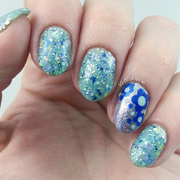 Glitter and flower accent nail art by Lindsay