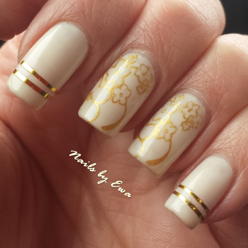 Gold stamped flowers nail art by Ewa