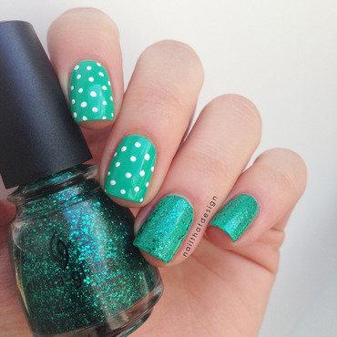 Dots and glitter - green version nail art by NailThatDesign