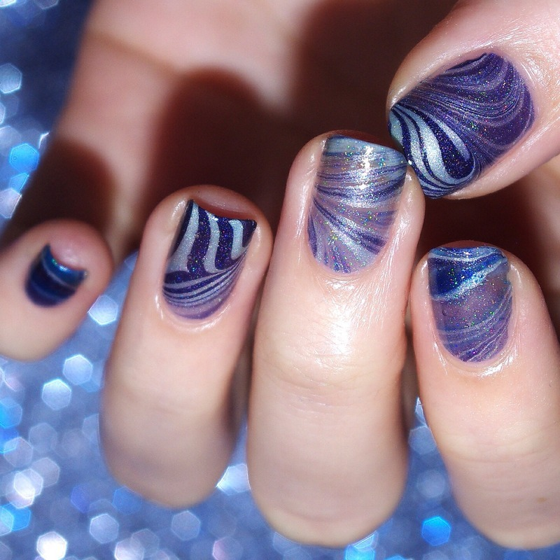 Blue holographic watermarble. nail art by Bulleuw