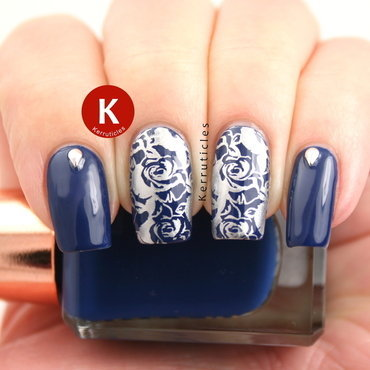 Navy and silver stamped roses nail art by Claire Kerr