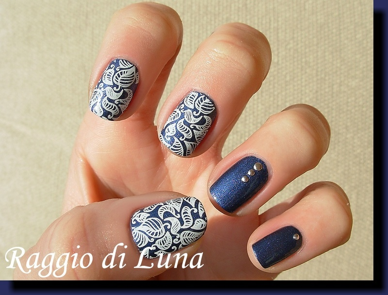 Stamping: White leaves skittlette on blue nail art by Tanja