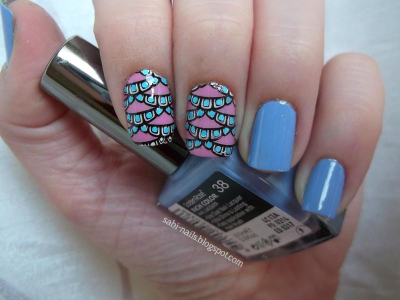 With dots. nail art by Sabina