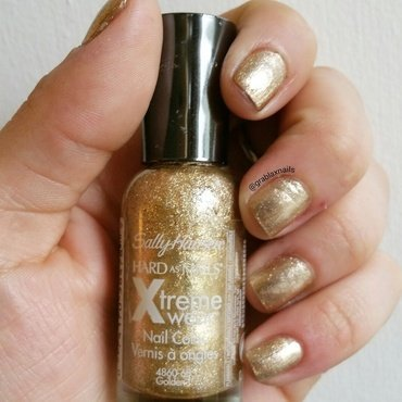 Sally Hansen Golden-I Swatch by Kristen Lovett