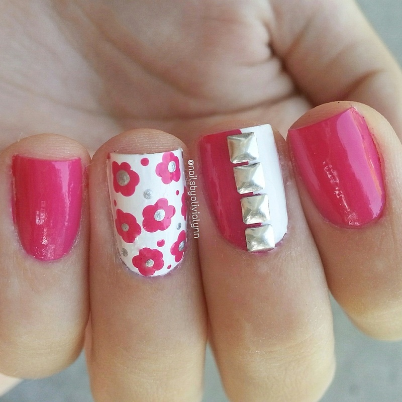 Flowers & Studs nail art by Olivia D.