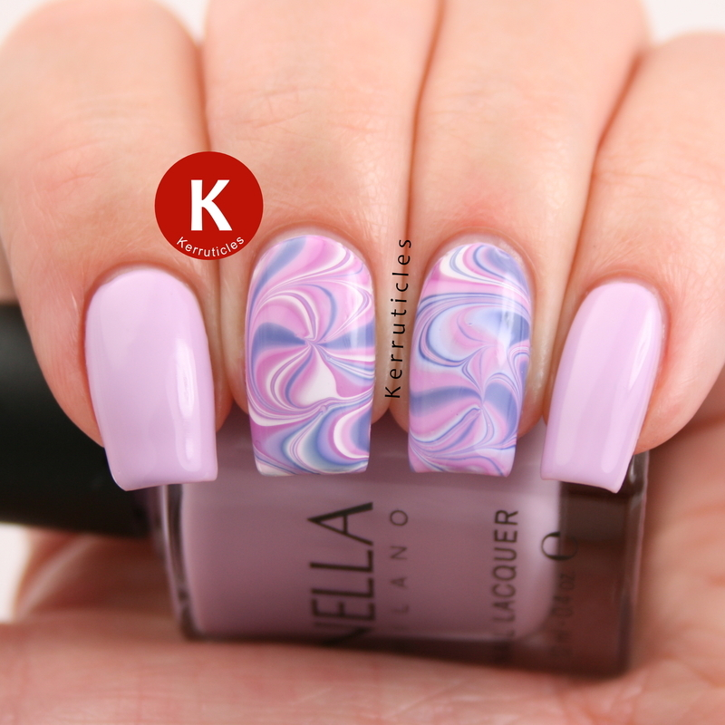 Lilac and purple swirl water marble nail art by Claire Kerr