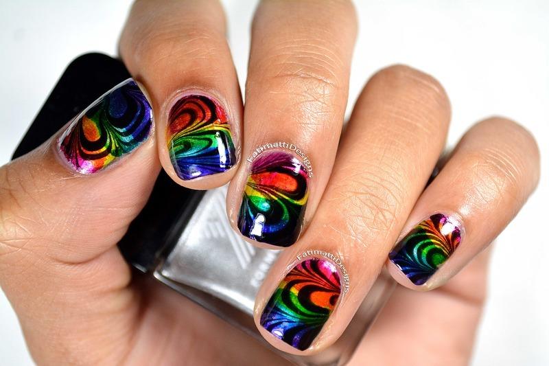 Rainbow Petal Water Marble nail art by Fatimah