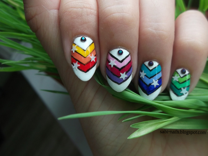 A little bit of rainbow nail art by Sabina