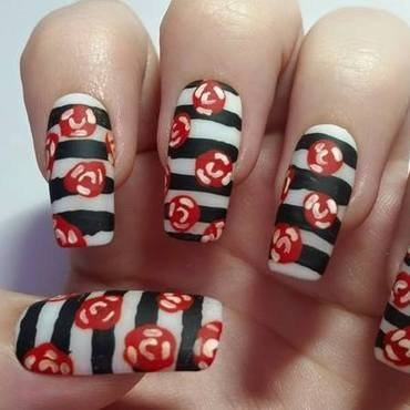 Rockabilly Black and white striped nails  nail art by Ellie Louise