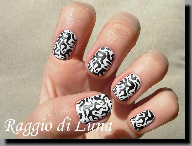 Stamping: Black & white tribal stamping nail art by Tanja