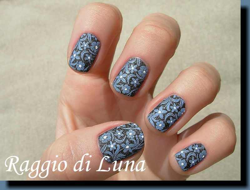 Stamping: Blue flowers on black nail art by Tanja