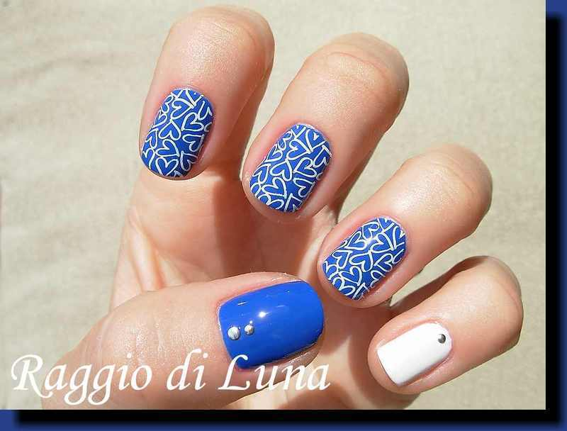 Stamping: White hearts on blue nail art by Tanja