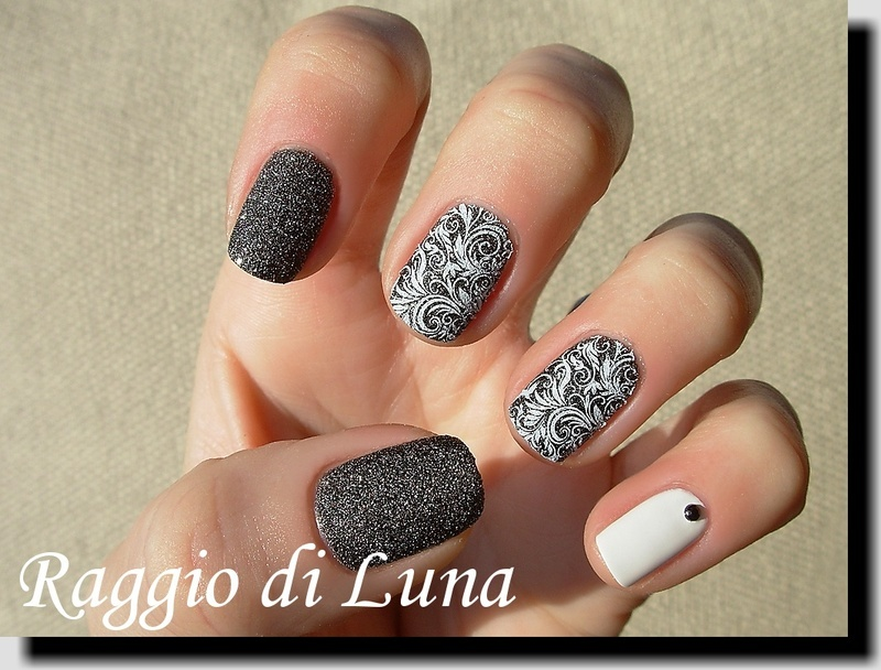 Stamping: White floral pattern on textured black nail art by Tanja
