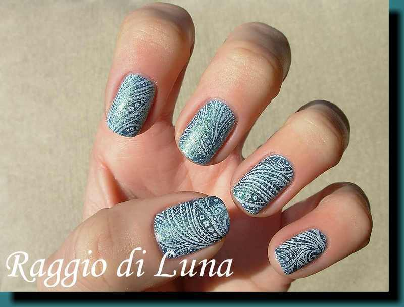 Stamping: White floral on sparkling peacock green nail art by Tanja