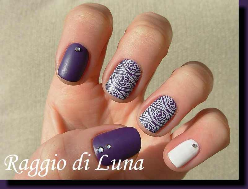 Stamping: White pattern on plum purple nail art by Tanja