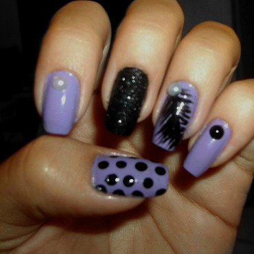 Feather and polka dots nails nail art by Jacquelin