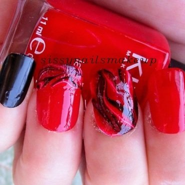 Red&black water marble nail art by sissynailsmakeup