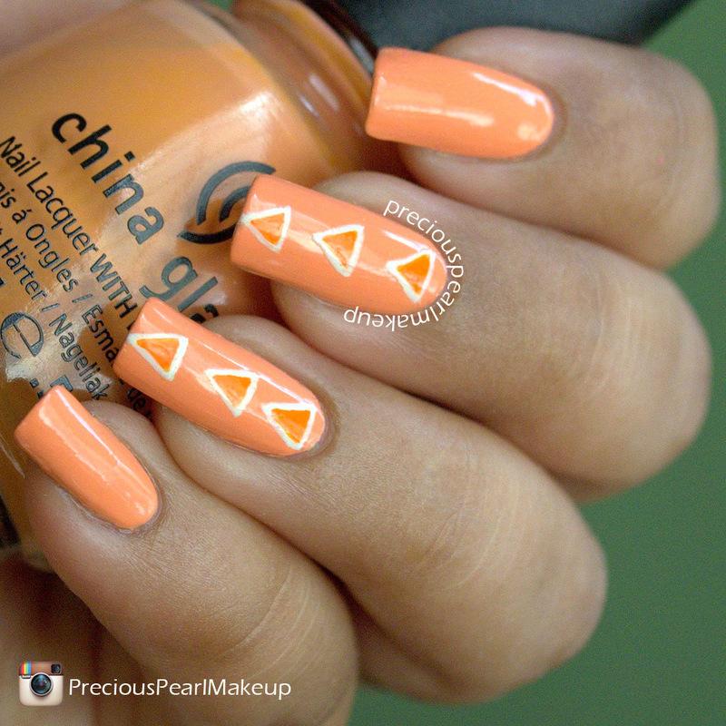 Peach Triangles nail art by Pearl P.