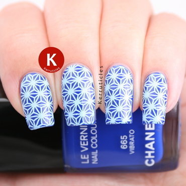 Royal blue with pale blue abstract stamping nail art by Claire Kerr