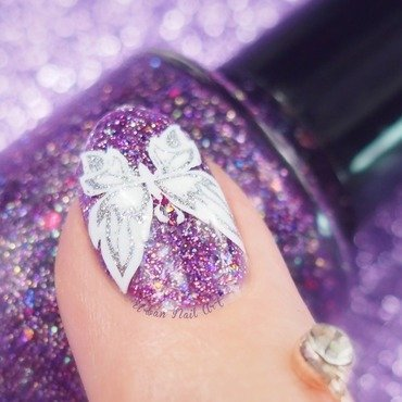 A close-up shot of Butterfly mani nail art by Lou
