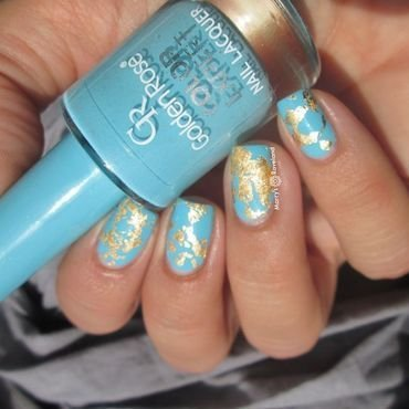 Golden blue nails nail art by Marina