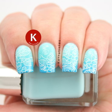 Aqua gradient with white floral stamping nail art by Claire Kerr