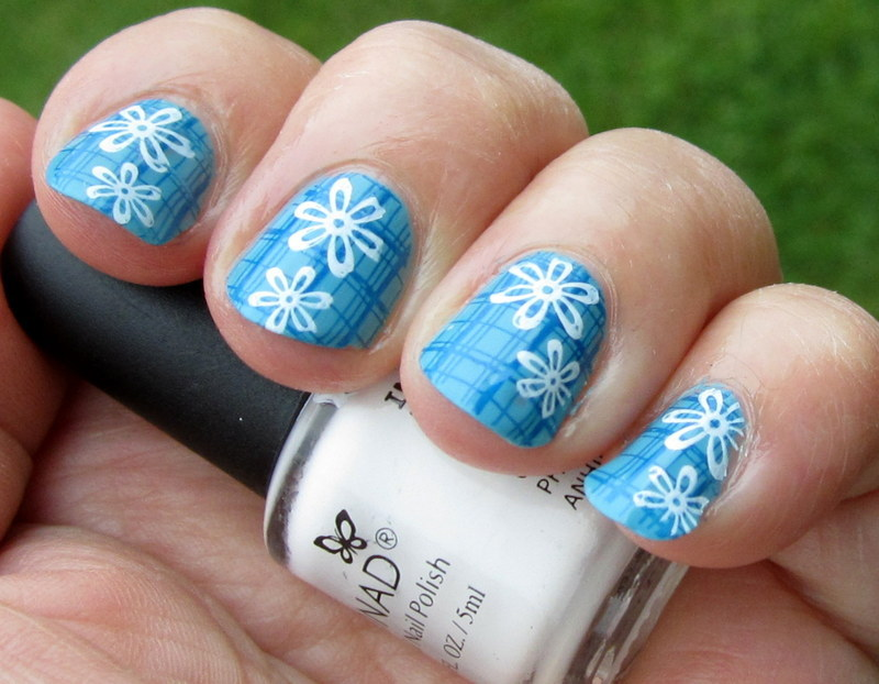 Flowers on Blue nail art by HELEN KAY