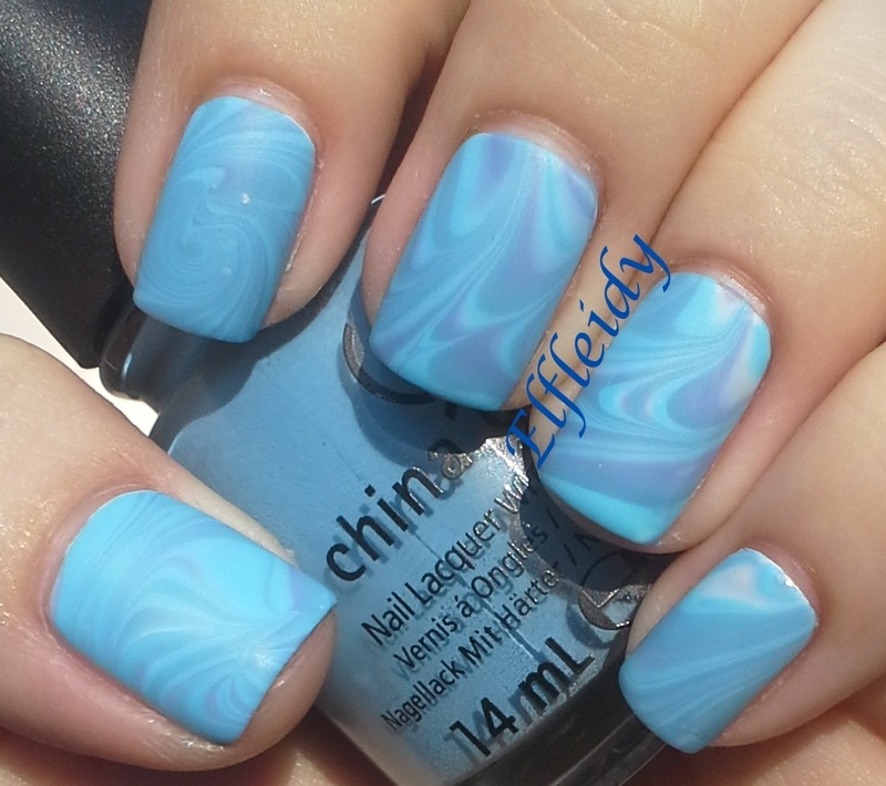 Cool blue water marble nail art by Jenette Maitland-Tomblin