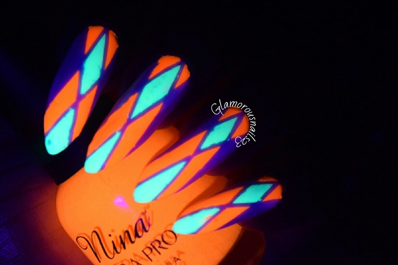 Solar Flame (Glow In The Dark) nail art by glamorousnails23