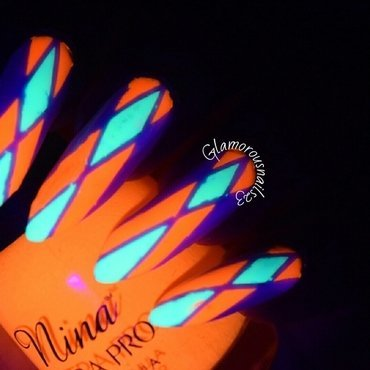 Solar Flame (Glow In The Dark) nail art by glamorousnails23