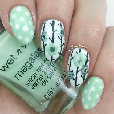 Polka dots and flowers nail art by Lindsay