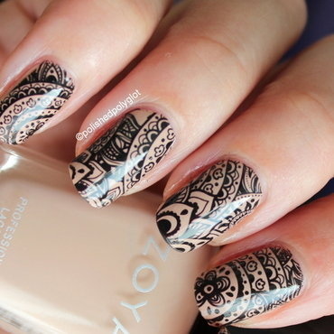 Black arabesques over nude nail art by Polished Polyglot