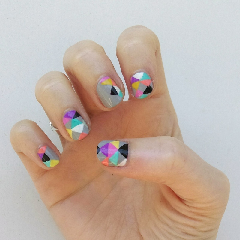 Freehand Triangles nail art by Sara