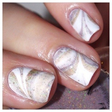 Watermarble Nude! nail art by Bulleuw