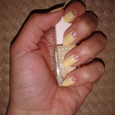 Yellow moon nail art by only real nails.