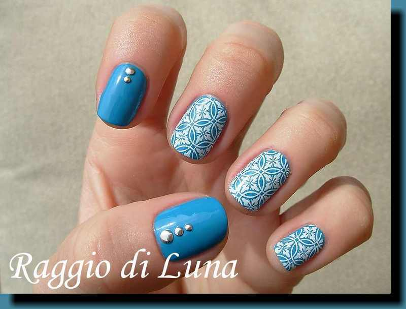 Stamping: White floral pattern on teal nail art by Tanja