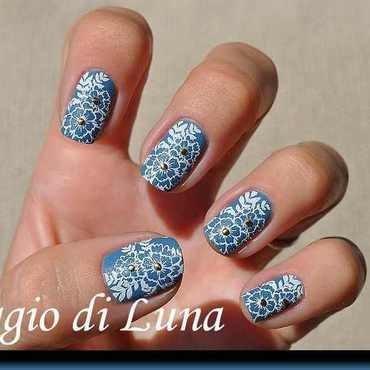 Stamping: White floral pattern on blue desert matte nail art by Tanja