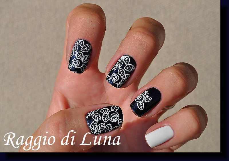 Stamping: White roses on dark blue nail art by Tanja